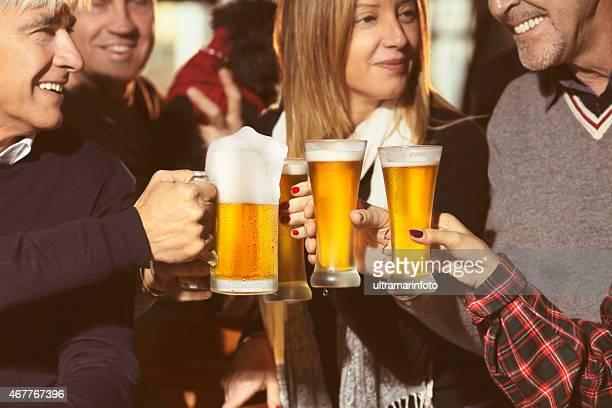 Cheers toasting glasses  Group of friends  enjoying in beer