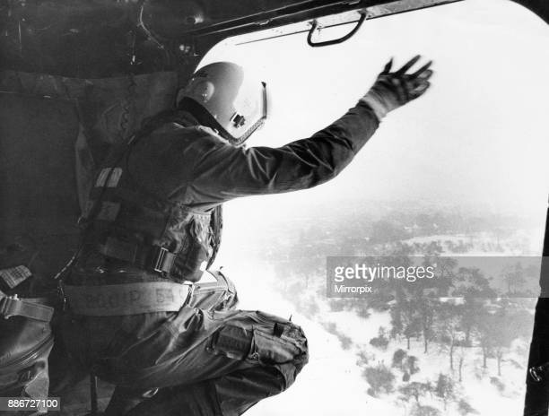 A cheery wave from Master ALM Bob Danes as the RAF helicopter from 202 Squadron at Leconfield flies a survey mission over the North Humberside's snow...