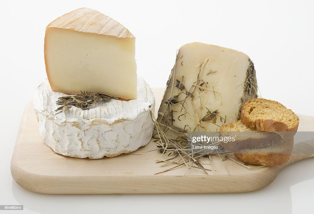 Cheese and bread on a cutting board