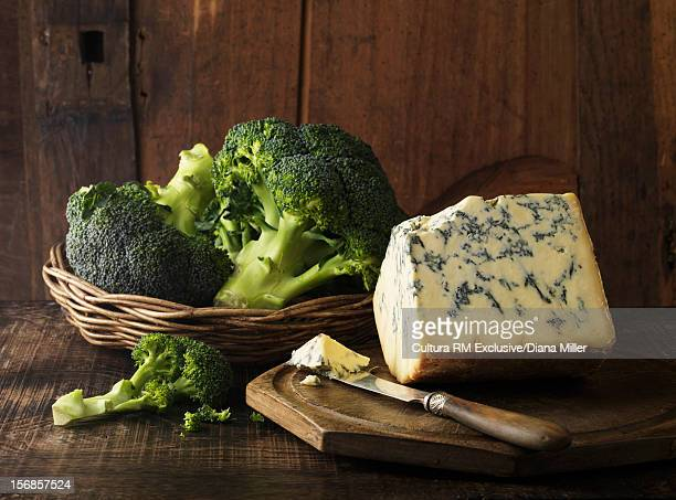 Cheese and broccoli on table