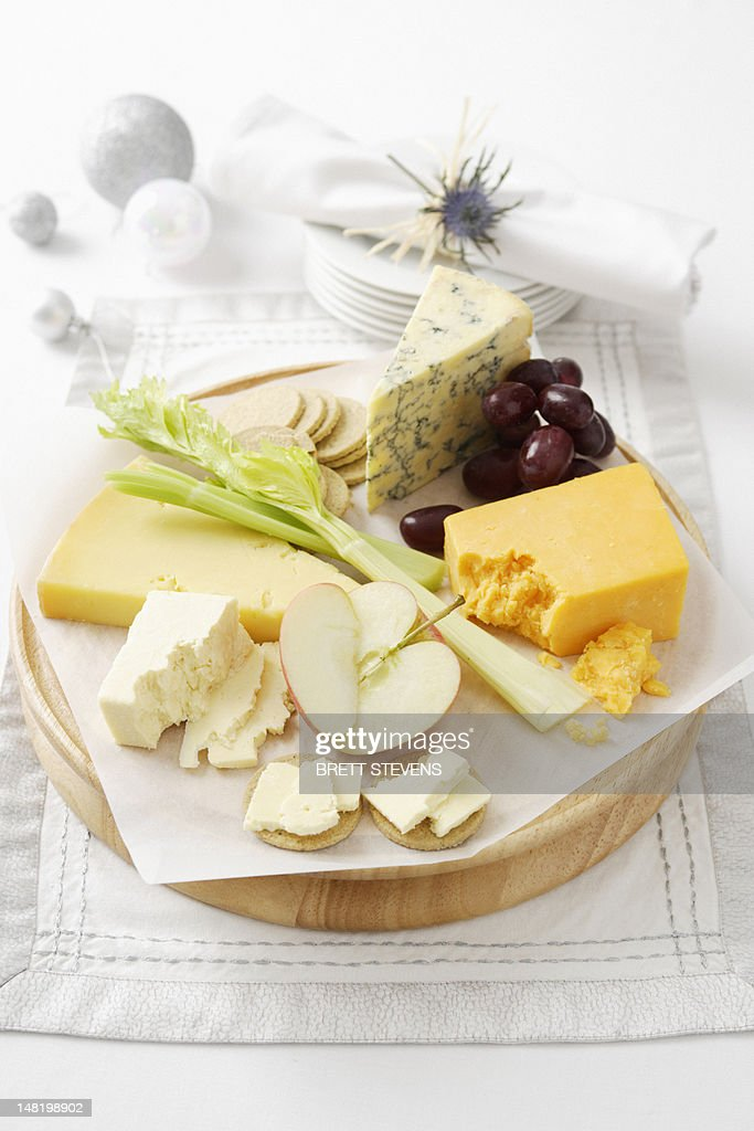 Cheese and fruit on wooden board : Stock Photo