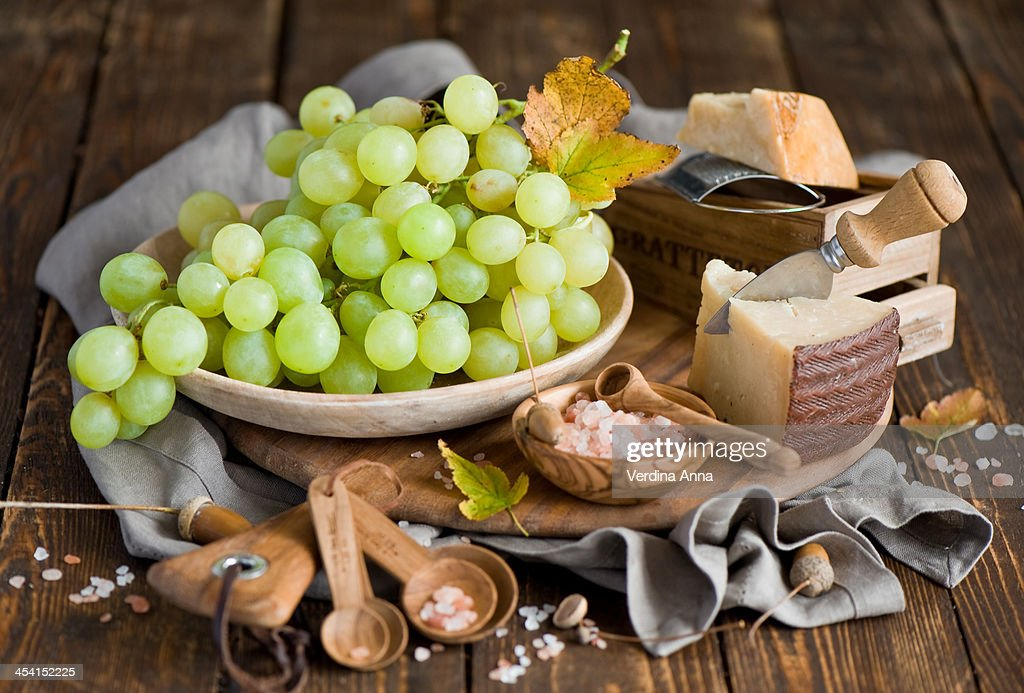 Cheese and grapes : Stock Photo
