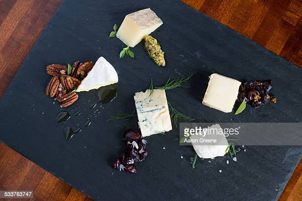 Cheese and herbs on cutting board