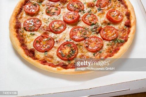 Cheese and tomato pizza with oregano in pizza box : Stock Photo
