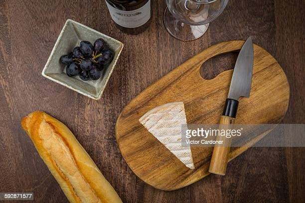 Cheese, bread, grapes and wine
