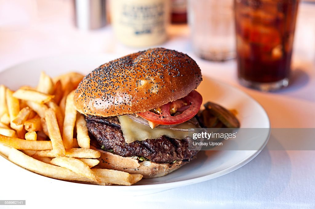 Cheese burger and french fries on restaurant table