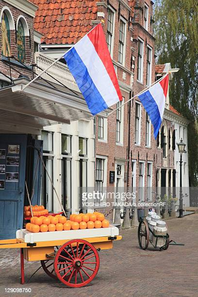 Cheese Cart and Dutch Flags Outside of Store