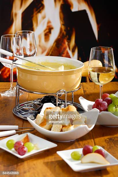 Cheese fondue with bread and grapes
