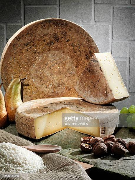 Cheese, fruit and grains on table