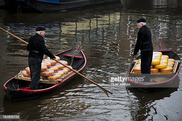 Cheese is been transported over the water during the official opening of the Cheese market season in Alkmaar the Netherlands on March 29 2013 The...