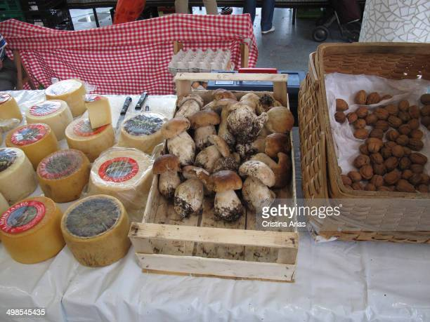 Cheese mushrooms and walnuts for sale on one of the posts of Tolosa's traditional market where every Saturday for several centuries the producers...