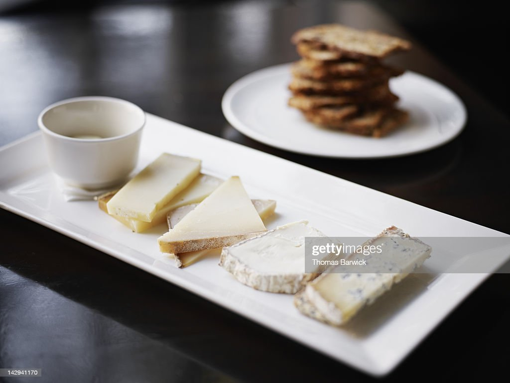 Cheese plate with house made crackers : Stock Photo
