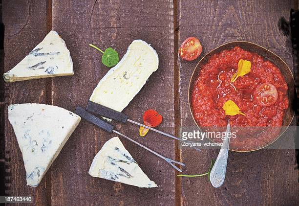Cheese plate with tomato chutney