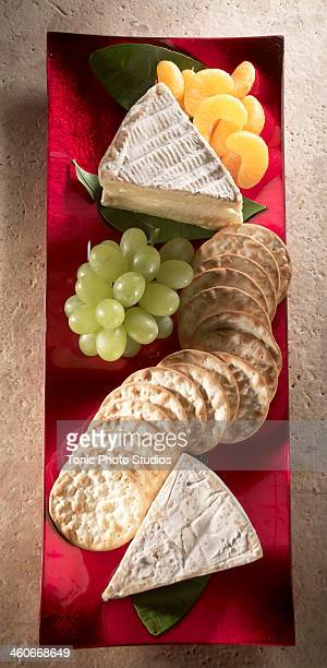 Cheese platter with crackers and fruit