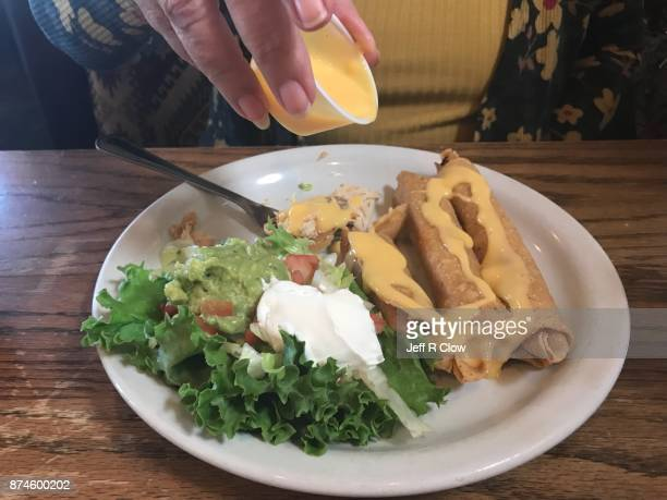 Cheese Sauce and Chicken Flautas in Texas