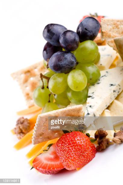 Cheese sellection in accompaniment with fruits and crackers