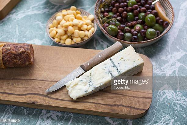 Cheese slice with olives and sweetcorns in kitchen