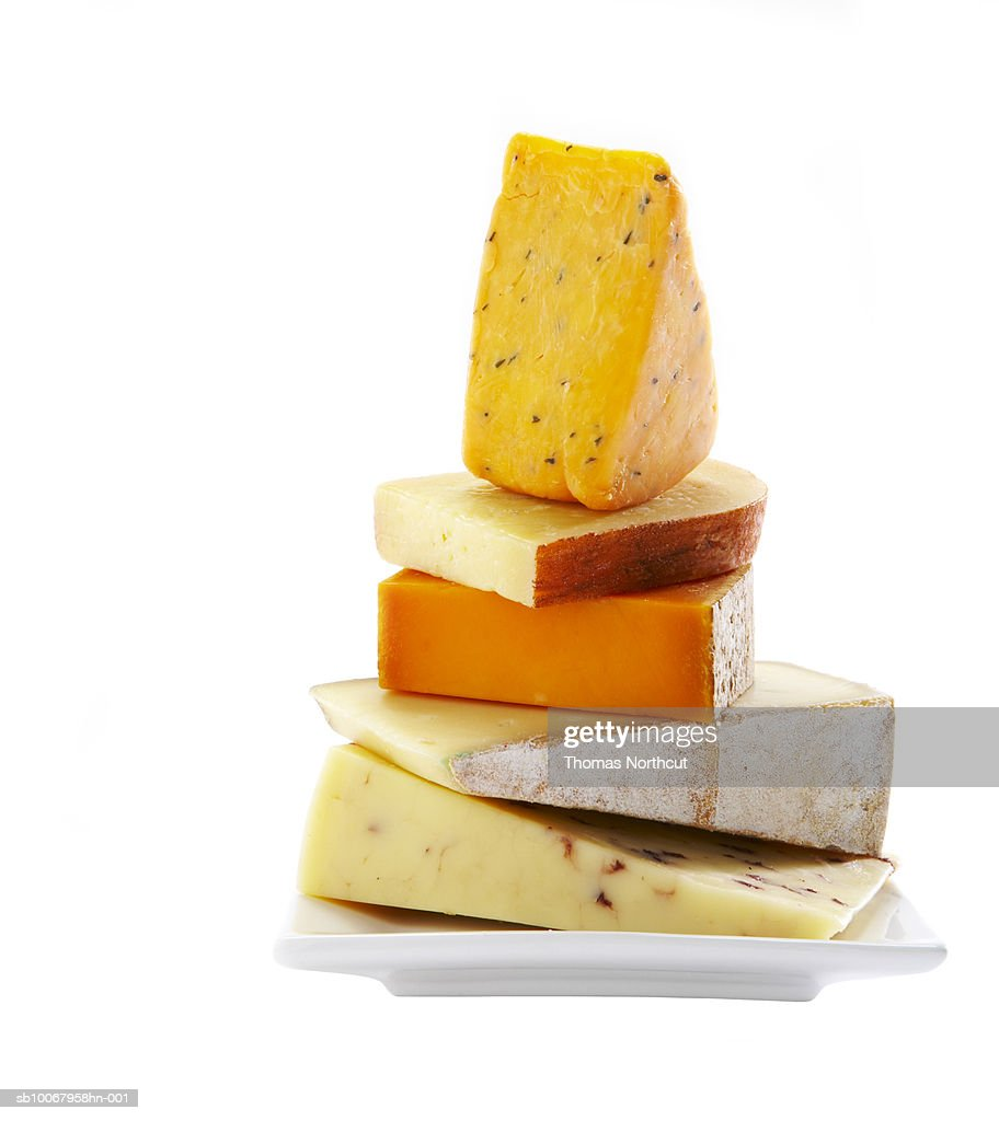 Cheese stacked on white background : Stock Photo