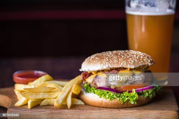 Cheeseburger and fries on restaurant table