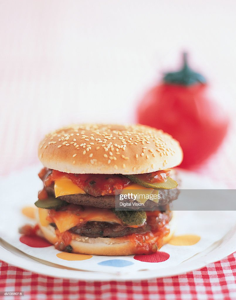 Cheeseburger on a Plate With tomato Ketchup : Stock Photo