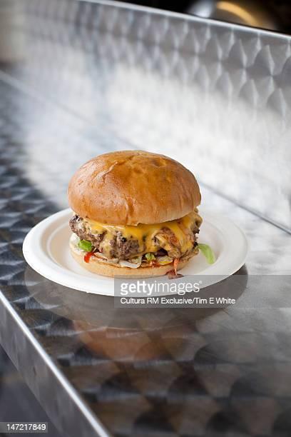 Cheeseburger on metal counter
