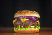 appetizing cheeseburger with red onion closeup