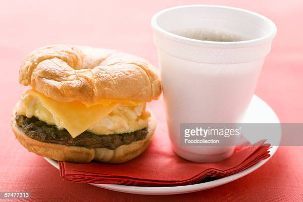 Cheeseburger with scrambled egg and a cup of coffee
