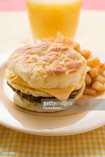 Cheeseburger with scrambled egg and fried potatoes
