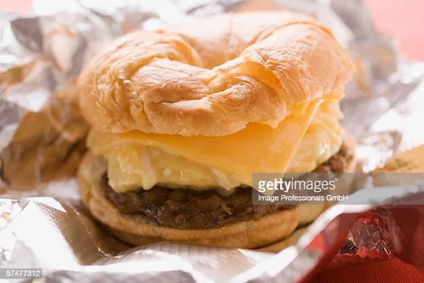 Cheeseburger with scrambled egg on aluminium foil