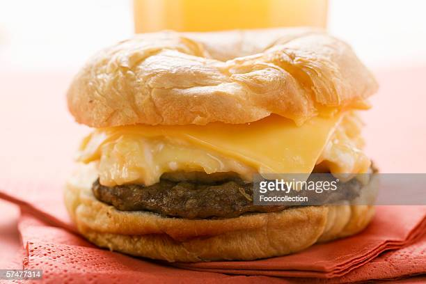 Cheeseburger with scrambled egg on napkin