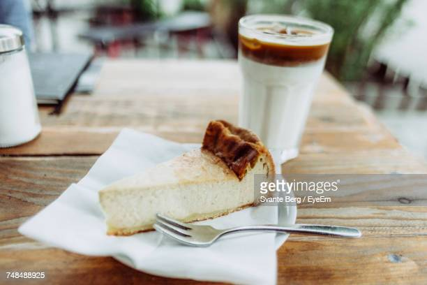 Cheesecake And Coffee On Restaurant Table