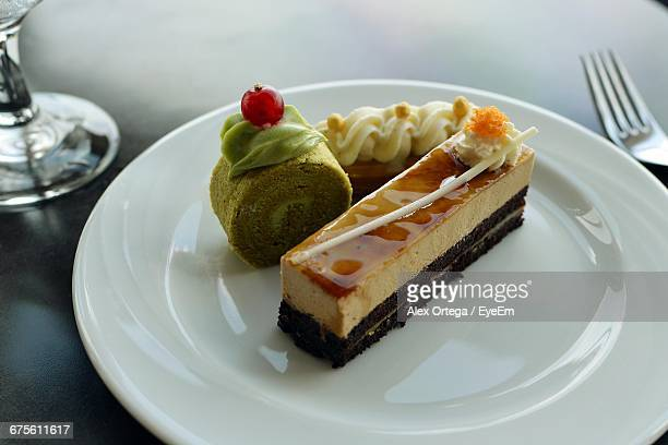 Cheesecake And Pistachio Swiss Roll On Plate