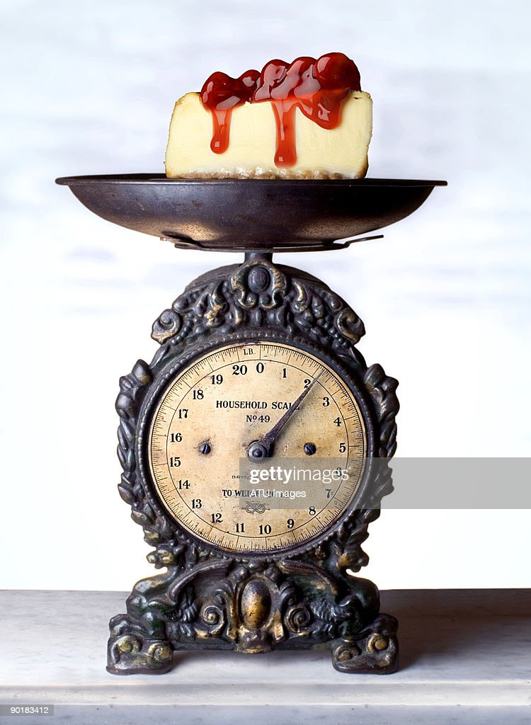 Cheesecake scale : Stock Photo