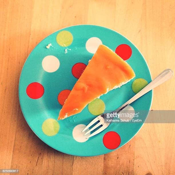 Cheesecake Slice On Spotted Plate
