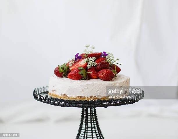 Cheesecake with fresh berries on wired stand