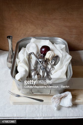 Cheesecloth with utensils in pan