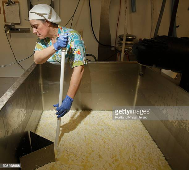 Cheesemaker Allison Lakin drains whey out of curds while making Opus 42 a semifirm cheese with a natural rind that is aged for three months Lakin...