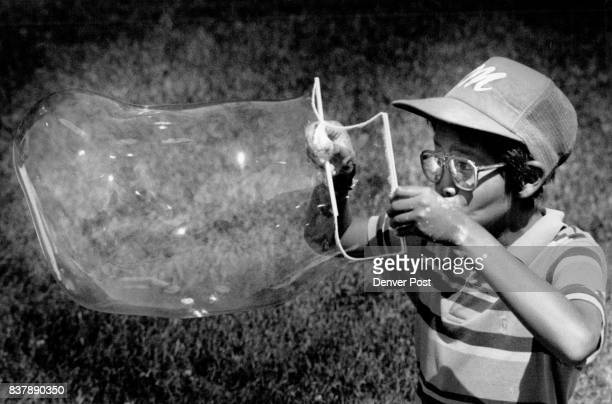 Cheeseman Park Kids from Wyman Elem Summer School Eddie Rodriguez Blows Bubbles in the park part of School Project Credit The Denver Post