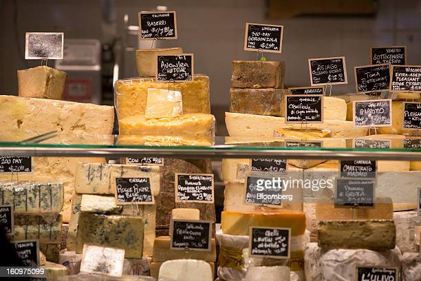 Cheeses are displayed for sale at an Eataly location in the Flatiron district of New York US on Wednesday Feb 6 2013 Eataly is a highend Italian food...