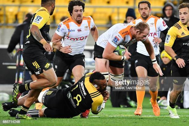 Cheetahs' Carl Wegner gets tackled by Hurricanes' Loni Uhila during the Super Rugby match between New Zealand's Hurricanes and South Africa's...