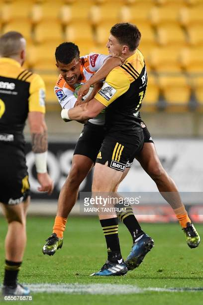 Cheetahs' Clayton Blommetjies is tackled by Hurricanes' Beauden Barrett during the Super Rugby match between New Zealand's Hurricanes and South...