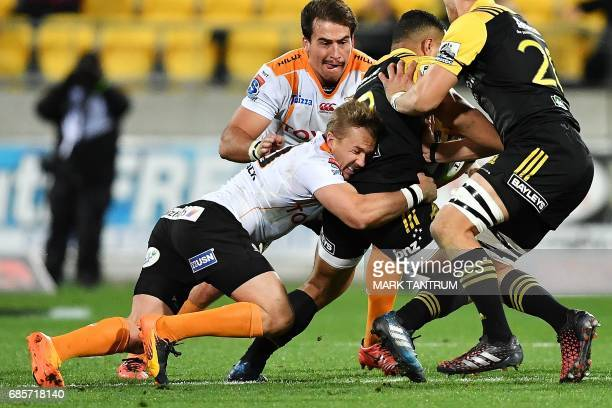 Cheetahs' Fred Zeilinga tackles Hurricanes' Ricky Riccitelli during the Super Rugby match between New Zealand's Hurricanes and South Africa's...