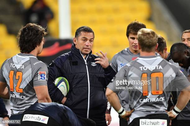 Cheetahs' head coach Franco Smith speaks to his team before the Super Rugby match between New Zealand's Hurricanes and South Africa's Cheetahs at...