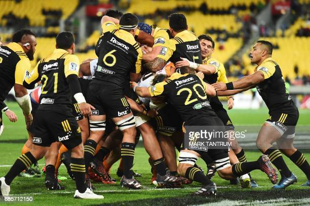 Cheetahs' players attempt to push over the try line as the Hurricanes' players defend during the Super Rugby match between New Zealand's Hurricanes...