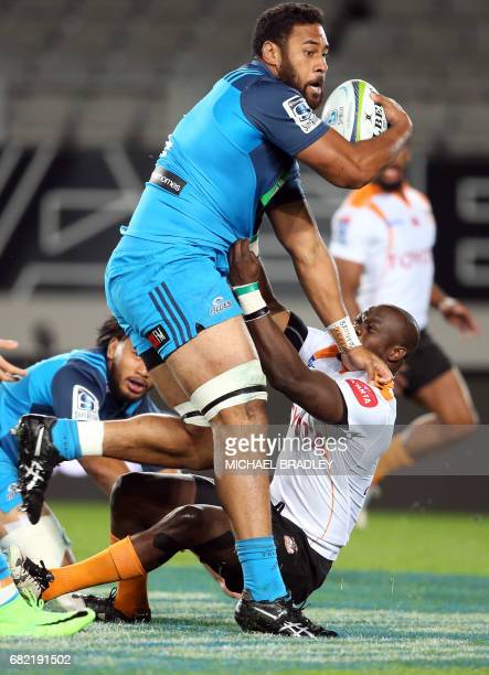 Cheetahs' Raymond Rhule takles Blues' Patrick Tuipulotu during the Super Rugby match between New Zealand's Blues and South Africa's Cheetahs at Eden...