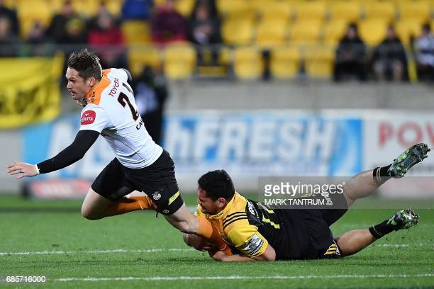 Cheetahs' Tian Meyer is tackled by Hurricanes' Leni Apisai during the Super Rugby match between New Zealand's Hurricanes and South Africa's Cheetahs...