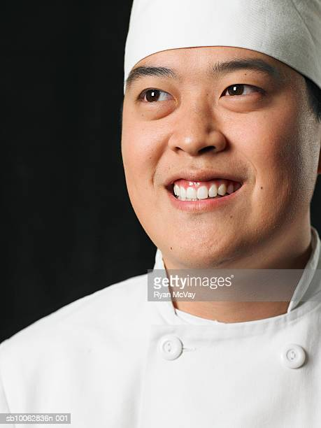 Chef against black background, head and shoulders