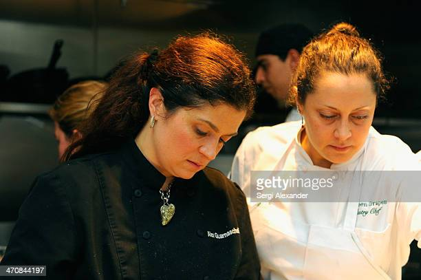 Chef Alex Guarnaschelli and guest attend Bella Cucina A Dinner Hosted By Alex Guarnaschelli With Dena Marino during the Food Network South Beach Wine...
