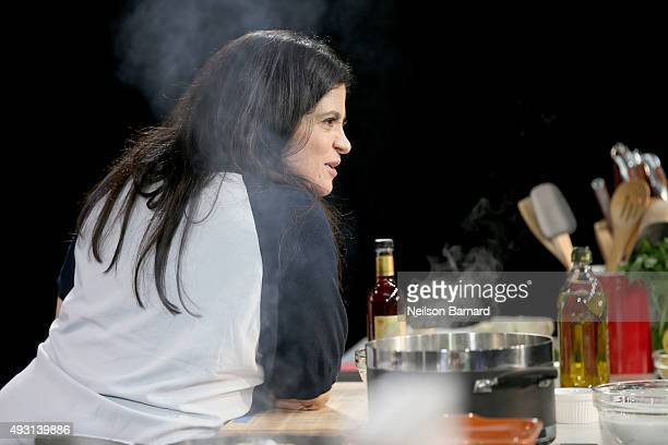 Chef Alex Guarnaschelli prepares food on stage during the Grand Tasting presented by ShopRite featuring Samsung culinary demonstrations presented by...