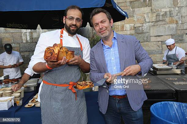 Chef Alon Shaya poses with Adam Sachs SAVEUR EditorInChief at The 7th Annual Saveur Summer Cookout at Boat Basin Cafe on June 21 2016 in New York City